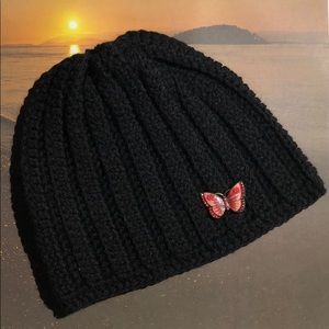 Lady's winter beanie hat with butterfly brooch
